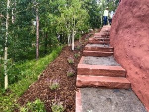 walkway with steps for steep hillside and retaining wall in Morrison Colorado